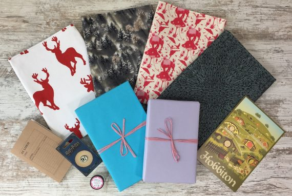 Book sleeves, 2 wrapped books and goodies