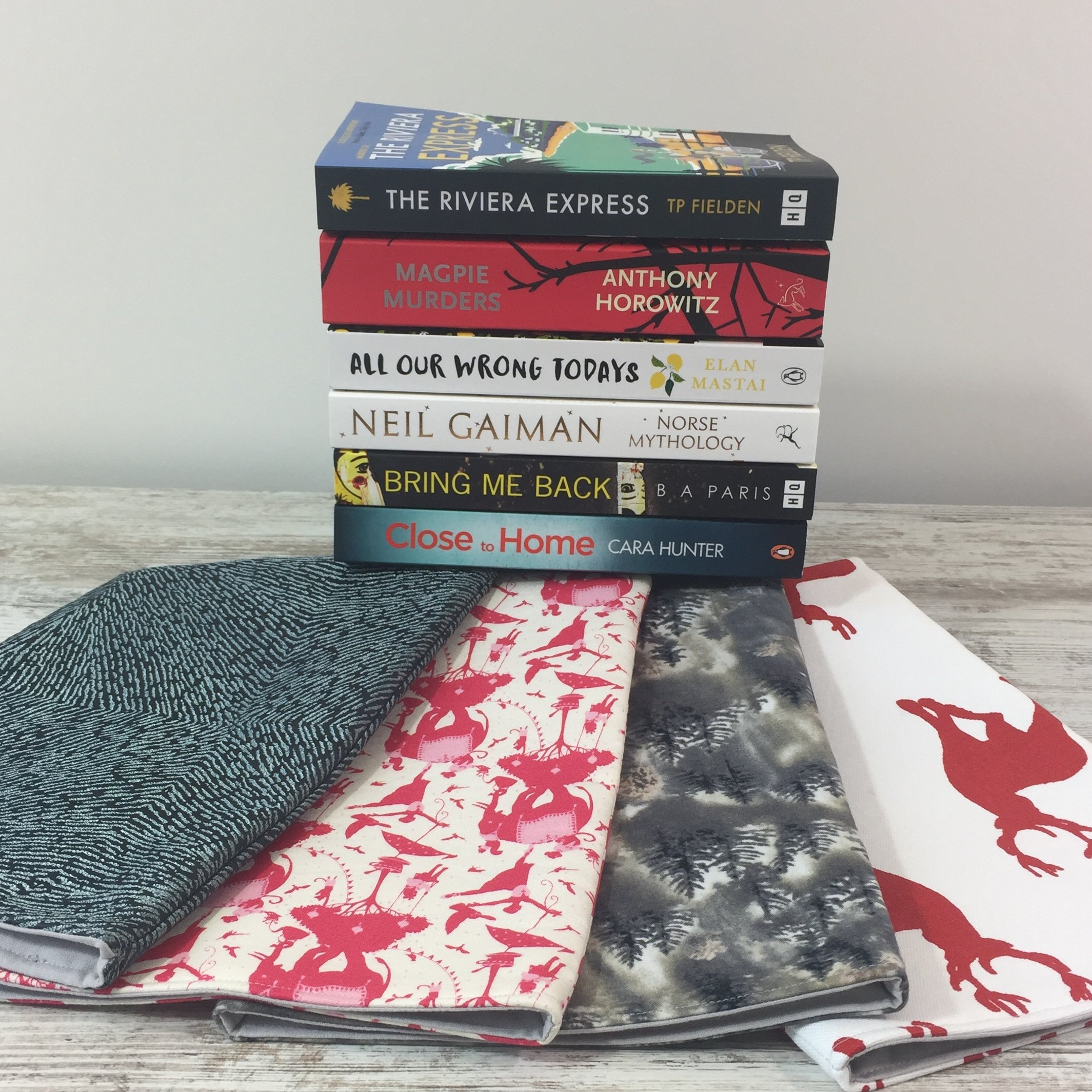 4 book sleeves and all 6 books
