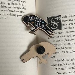 Raven wooden pin on book